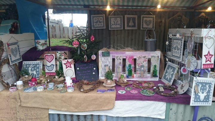 Willow wreaths, gifts & upcycled products on market stall by Purple Sue