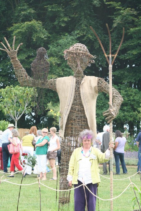 Willow sculpture by Purple Sue - Large Scarecrow with sculptor, Purple Sue - Tatton Show Feature Scarecrow