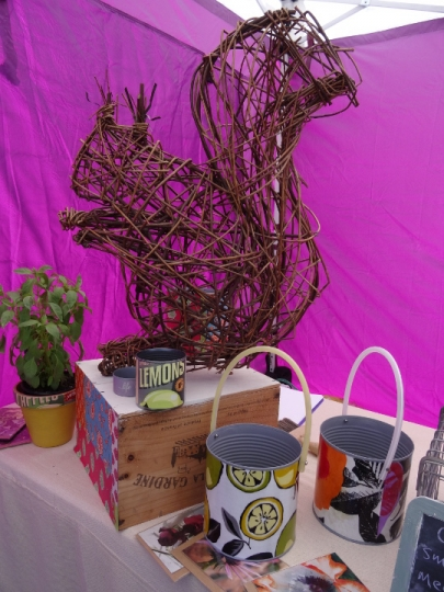 Squirrel willow sculpture with some upcycled products at market stall by Purple Sue