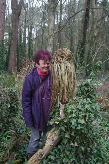 Welsh sculptor, Purple Sue with giant owl willow sculptor