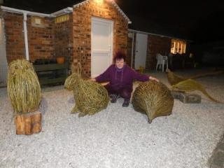 Welsh sculptor, Purple Sue with giant willow sculptors of owl, rabbit, hedgehog & pheasants