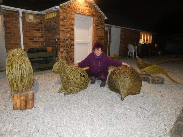 Welsh sculptor, Purple Sue with giant willow sculptors of owl, rabbit, hedgehog & pheasants